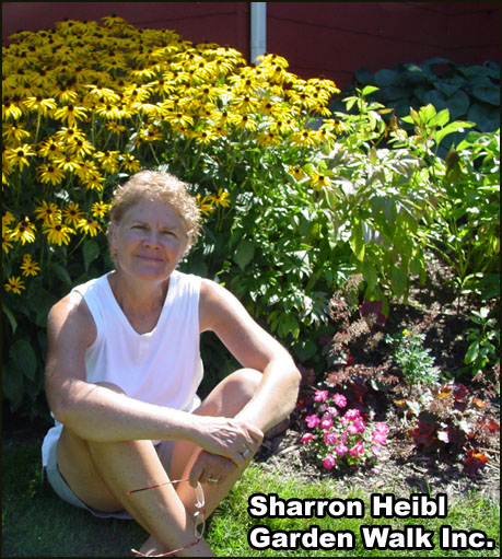 Cancer survivor Sharrie Heibl pictured with one of her gardens.
